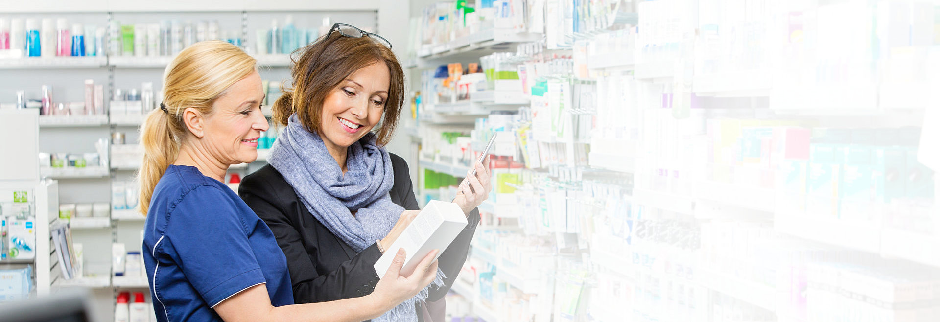 female pharmacist recommending medicine to female customer