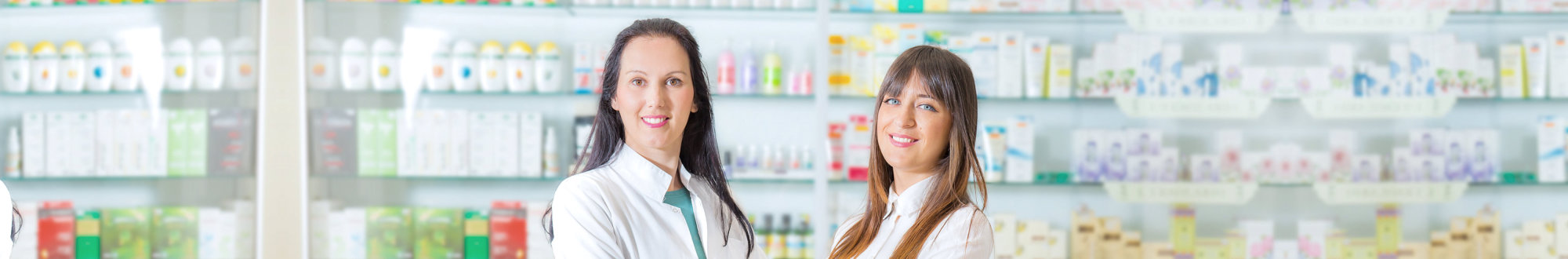 two female pharmacists smiling